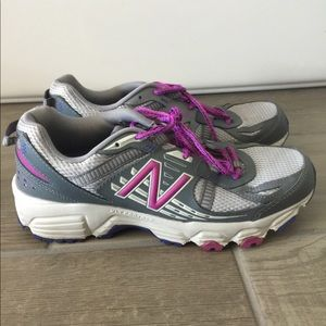New Balance purple and gray running shoes.